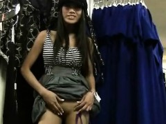 Brunette teen dares to rub her cunt in a clothing store
