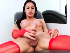 Sexy hot tranny in red stockings handjobs until she cums